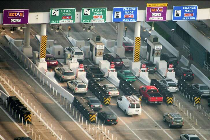 Drivers crowd the toll plaza on Sam Houston Tollway near U.S. 290 on May 17, 2013, in Houston.