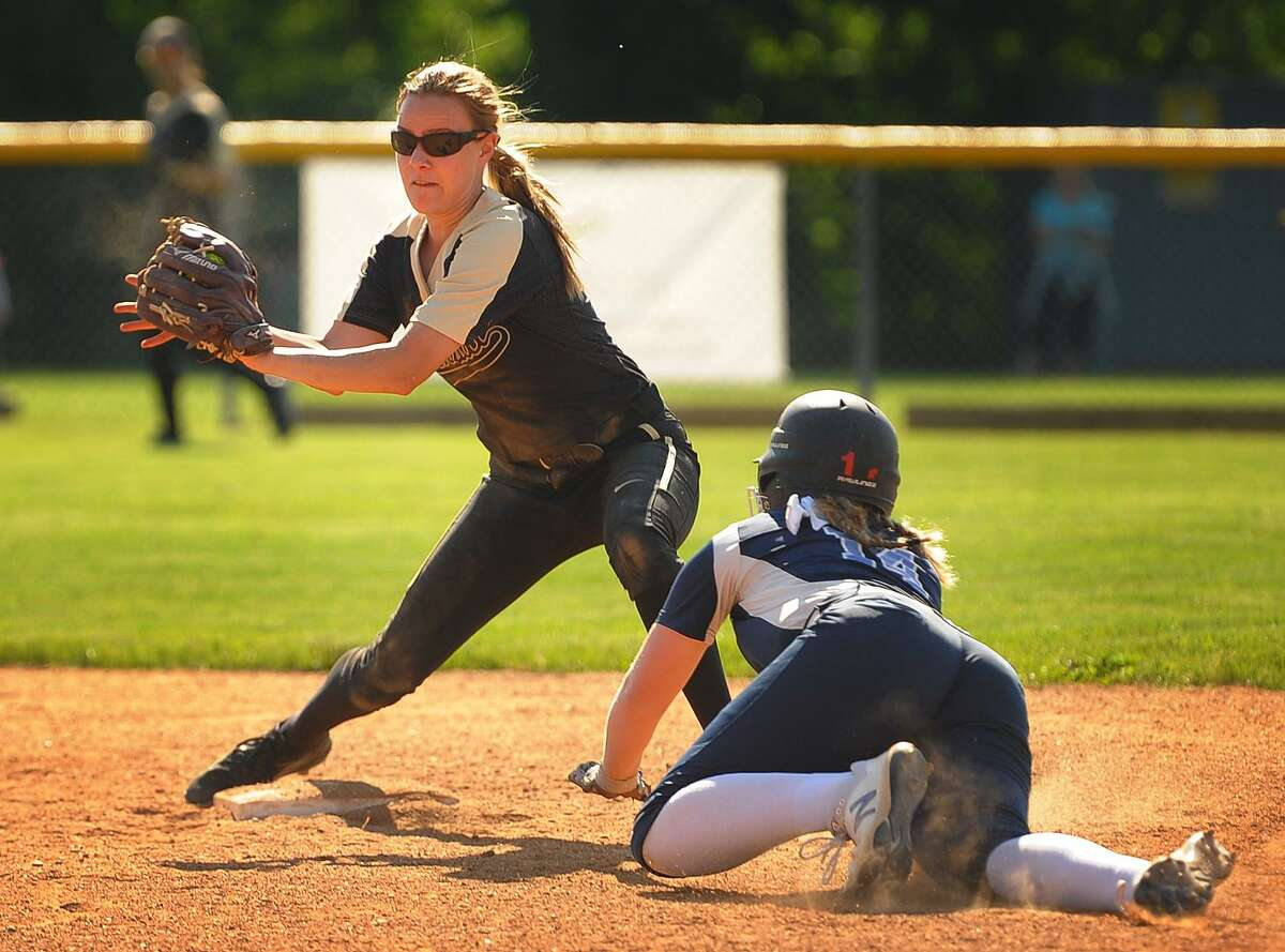 Trumbull second baseman Meg Geraghty takes the throw before tagging out Middletown's Carly Gessaro trying to steal second in the 4th inning on Wednesday.