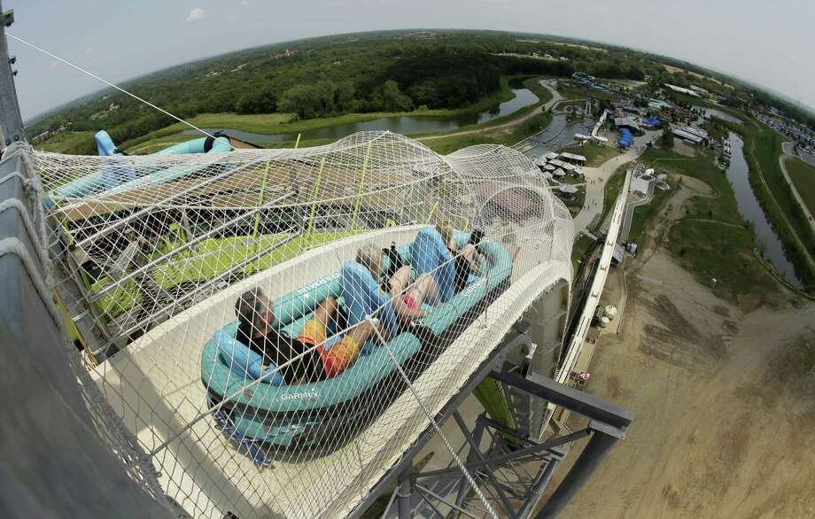 """FILE - In this July 9, 2014, file photo, riders go down the water slide called """"Verruckt"""" at Schlitterbahn Waterpark in Kansas City, Kan. A former executive with the Kansas water park where a 10-year-old boy died on the giant waterslide has been charged with involuntary manslaughter. Tyler Austin Miles, an operations director for Schlitterbahn, was booked into the Wyandotte County jail Friday, March 23, 2018 and is being held on $50,000 bond. Caleb Schwab died in August 2016 on the 17-story Verruckt water slide at the park in western Kansas City, Kansas. (AP Photo/Charlie Riedel, File) Photo: Charlie Riedel, STF / AP / Copyright 2018 The Associated Press. All rights reserved."""