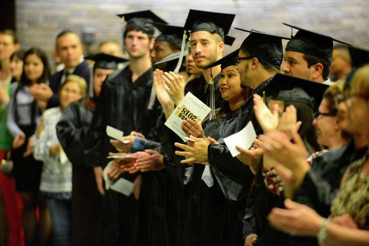 Graduates applaud during the Stamford Public Schools Adult & Continuing Education graduation ceremony at Cloonan Middle School on May 30, 2018 in Stamford, Connecticut.