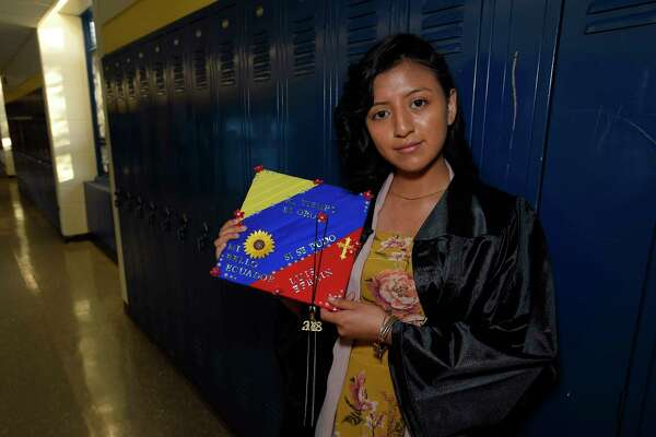 Yesenia Pelaez, 17, of Stamford holds her graduation cap she decorated in memory of her father prior to Stamford Public Schools Adult & Continuing Education graduation ceremony at Cloonan Middle School on May 30, 2018 in Stamford, Connecticut. The words on her cap translated Time is Gold, My Beautiful Ecuador, Yes, It Could Be Done, Luis Efrain.