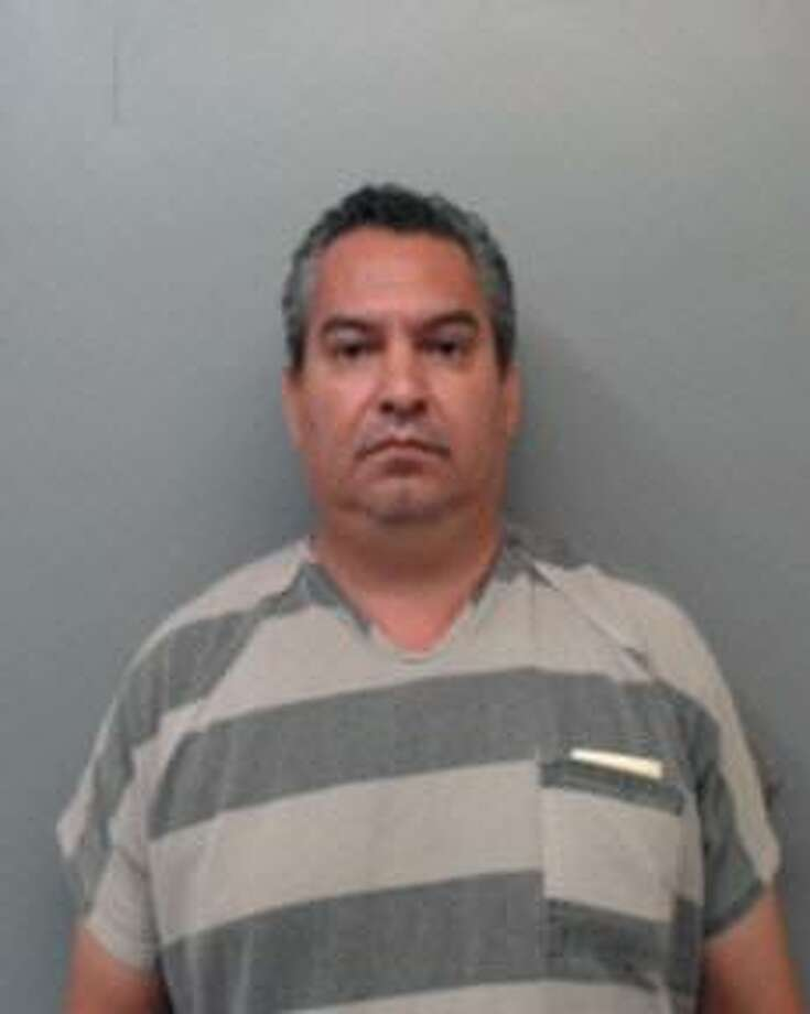 Victor Manuel Estrada was served with an arrest warrant that charged him with a third-degree felony punishable by up to 10 years behind bars and a $10,000 fine. Photo: Webb County Sheriff's Office