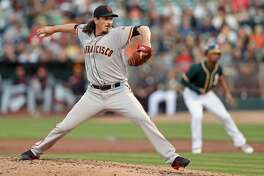 San Francisco Giants' Jeff Samardzija delivers in 1st inning against Oakland Athletics during MLB game at Oakland Coliseum in Oakland, Calif. on Tuesday, August 1, 2017.