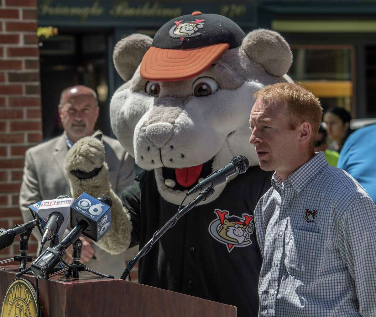 Matt Callahan, general manager of the Tri-City ValleyCats tells the gathering about the various events related to his baseball team that will occur during the summer months with a left-handed assist from Southpaw the team mascotat a press briefing Monday May 29, 2018 in Troy, N.Y. (Skip Dickstein/Times Union)