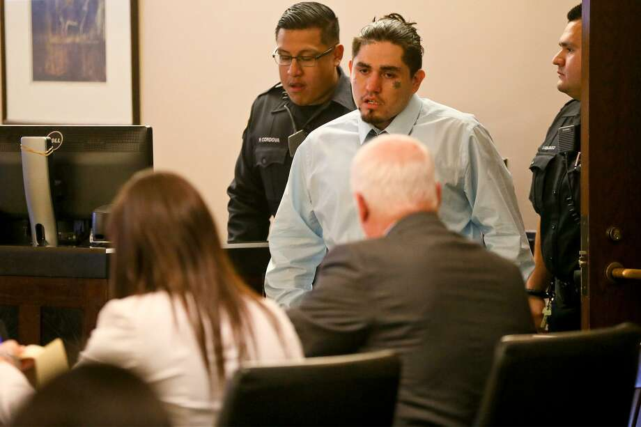Daniel Lopez (top center) enters the court room during the third day of testimony in his retrial  in the 379th state District Court at the Cadena-Reeves Justice Center on Wednesday, May 30, 2018. Lopez is accused with two others of beating, dismembering and burning body parts of his girlfriend's cousin, Jose Luis Menchaca, in retaliation over a stabbing in a drug deal gone bad.  MARVIN PFEIFFER/mpfeiffer@express-news.net Photo: Marvin Pfeiffer, Staff / San Antonio Express-News / Express-News 2018