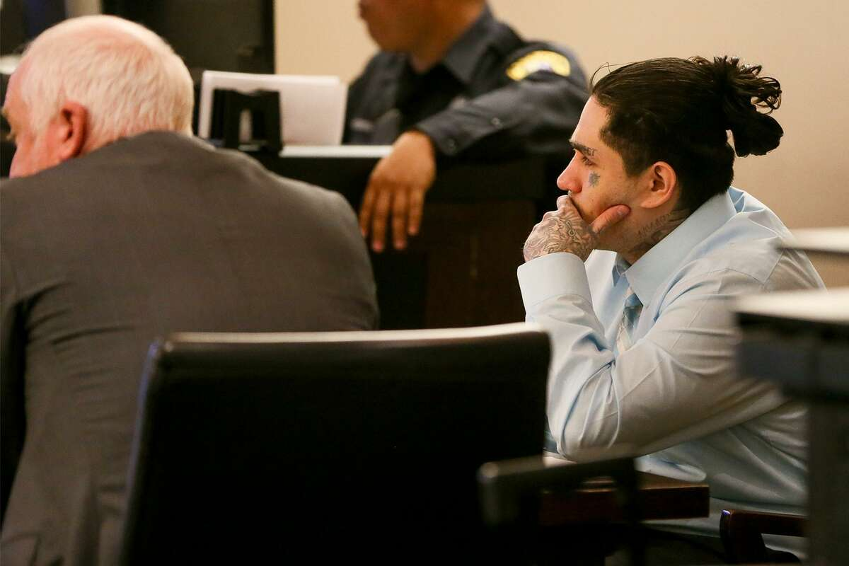 Daniel Lopez (right) watches testimony by witness Dennis Austinduring the third day of testimony in his retrial in the 379th state District Court at the Cadena-Reeves Justice Center on Wednesday, May 30, 2018. Lopez is accused with two others of beating, dismembering and burning body parts of his girlfriend's cousin, Jose Luis Menchaca, in retaliation over a stabbing in a drug deal gone bad. MARVIN PFEIFFER/mpfeiffer@express-news.net