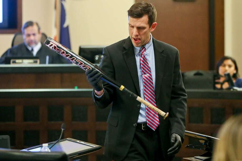 Prosecutor Matthew Ludowig holds a metal baseball bat, state's exhibit 216 that was found in Candi Dominguez's bedroom, during the third day of testimony in the retrial of Daniel Lopez  in the 379th state District Court at the Cadena-Reeves Justice Center on Wednesday, May 30, 2018. Lopez is accused with two others of beating, dismembering and burning body parts of his girlfriend's cousin, Jose Luis Menchaca, in retaliation over a stabbing in a drug deal gone bad.  MARVIN PFEIFFER/mpfeiffer@express-news.net Photo: Marvin Pfeiffer, Staff / San Antonio Express-News / Express-News 2018
