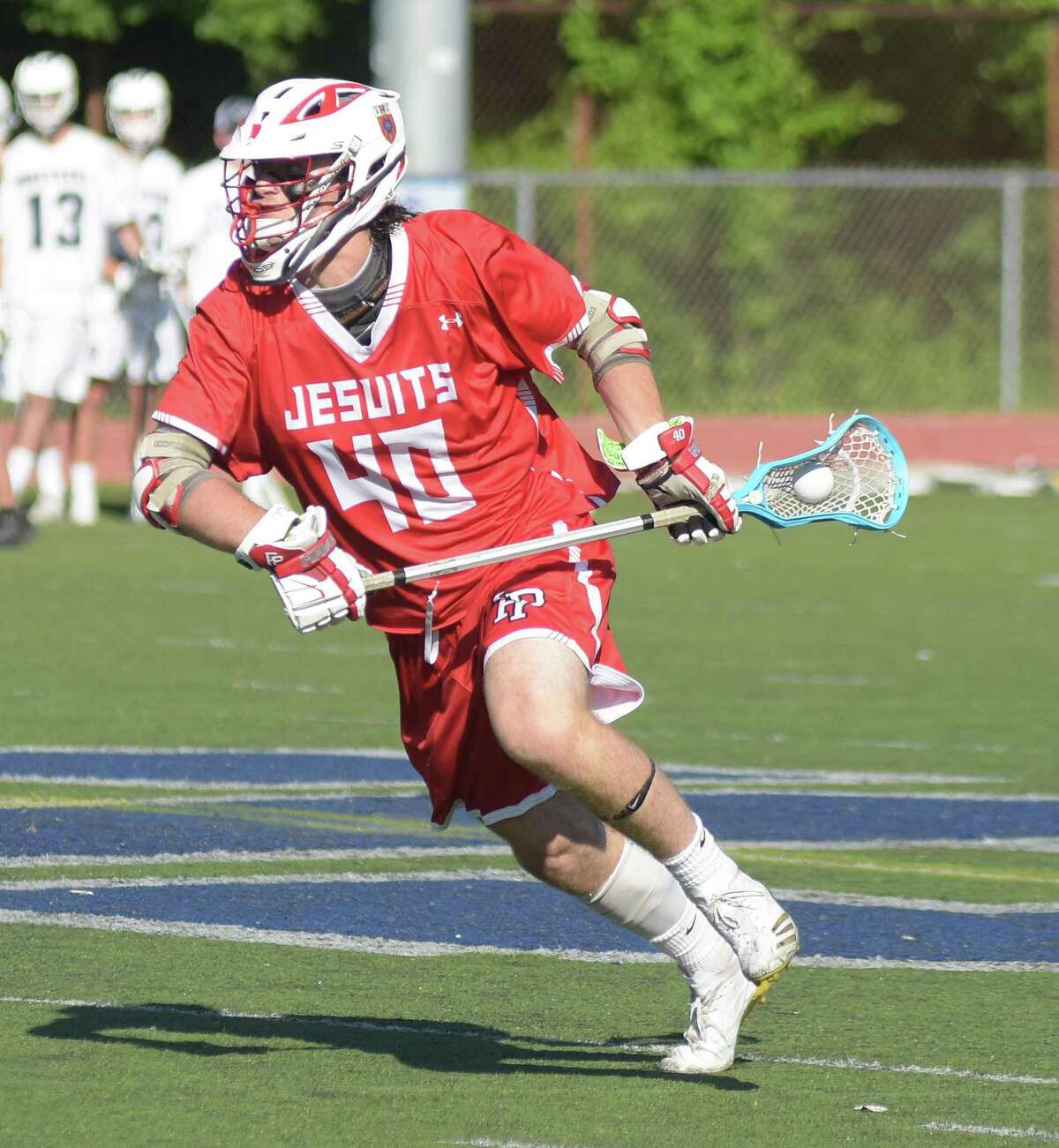 Fairfield Prep?'s Thomas Walton heads toward goal during Wednesday?'s Class L state tournament first round game against Staples in Westport. Prep won 11-10 in overtime.