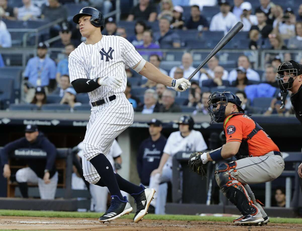 New York Yankees' Aaron Judge follows through on a single during the first inning as Houston Astros catcher Max Stassi, right, watches during a baseball game Wednesday, May 30, 2018, in New York. (AP Photo/Frank Franklin II)