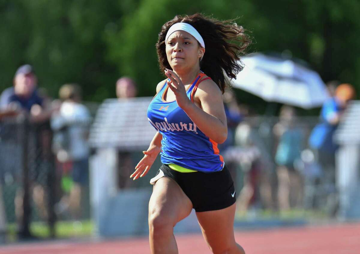 Asiyah McClain of the Danbury Hatters competes in the 100 meter dash during the Class LL State Track and Field Championship on Wednesday May 30, 2018, at Willow Brook Park in New Britain, Connecticut.