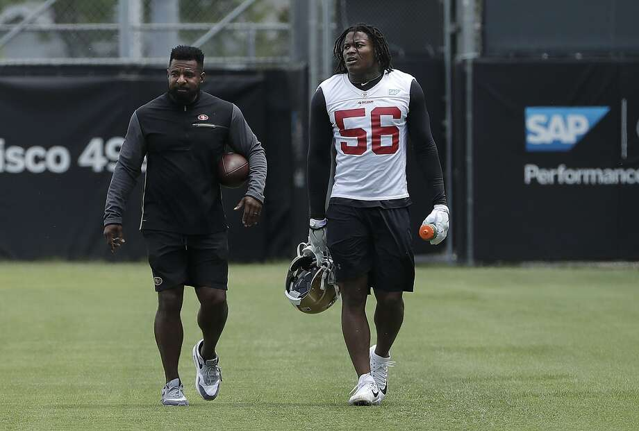 San Francisco 49ers linebacker Reuben Foster (56) walks on the field with assistant coach Ray Wright during a practice at the team's NFL football training facility in Santa Clara, Calif., Wednesday, May 30, 2018. (AP Photo/Jeff Chiu) Photo: Jeff Chiu / Associated Press