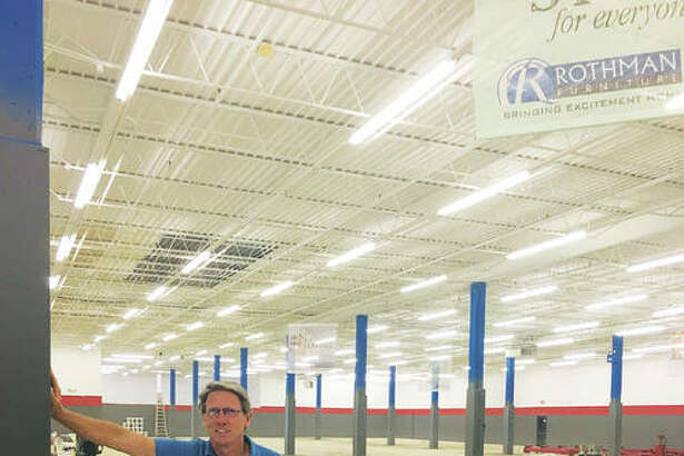 Andy's Automotive Group co-owner Mark Anderson stands in the former Rothman Furniture building where he is moving his business, currently made up of two Alton locations: Andy's Tire and Auto at Alton Square Mall and Andy's Auto Body at 3444 E. Broadway. The move to 3001 Washington Ave., off of Homer Adams Parkway, will put both of those locations under one roof in Alton.