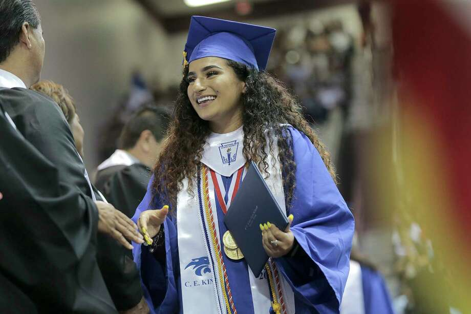 C.E. King senior Leira Salene receives her diploma at MO Campbell Center on Wednesday, May 30, 2018 in Houston. Salene overcame Harvey flooding to be named among the top 10 percent in her class. Photo: Elizabeth Conley, Houston Chronicle / ©2018 Houston Chronicle