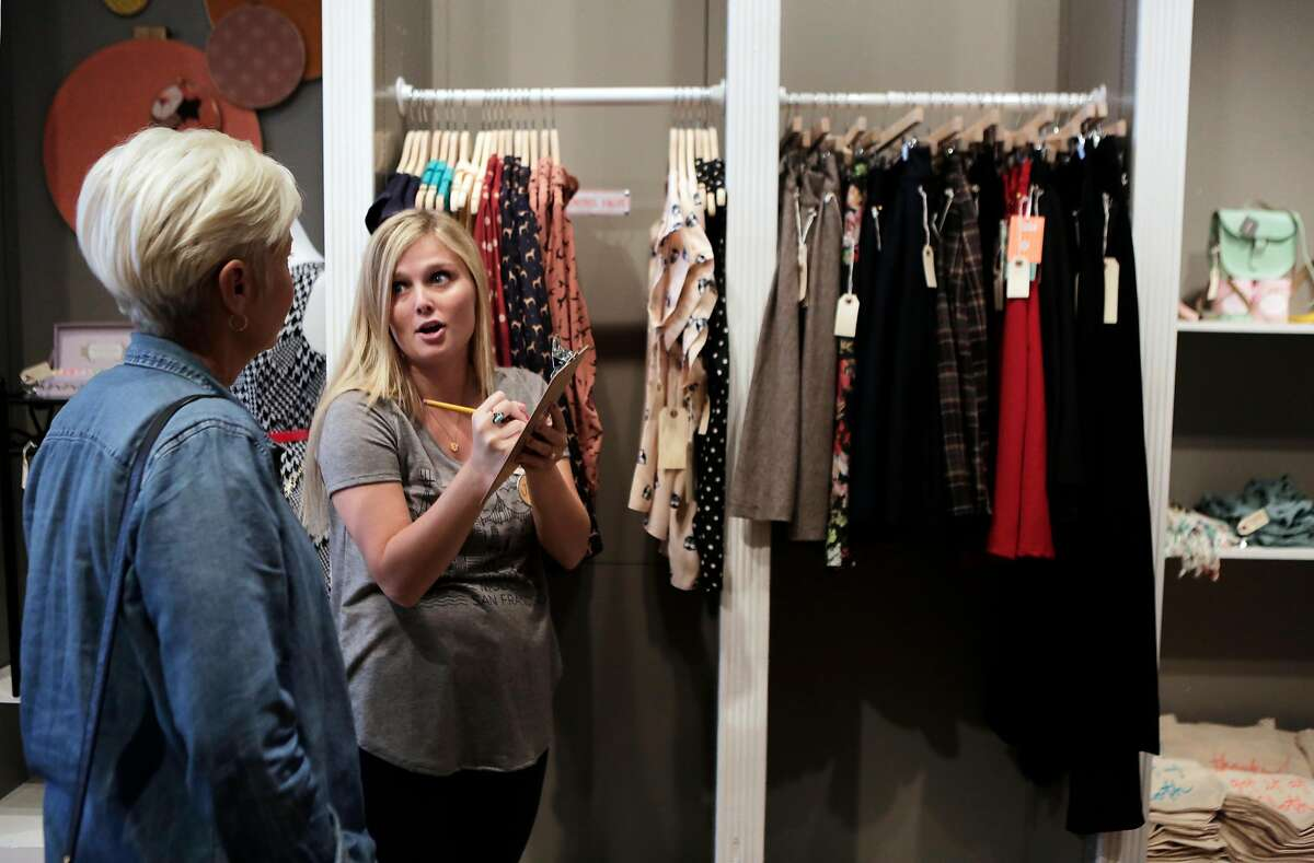 Monica Caliri, left, of Los Angeles shops with the help of stylist Jenna Cianelli of San Francisco during the soft opening of ModCloth Fit Shop in San Francisco on Monday, July 27, 2015.