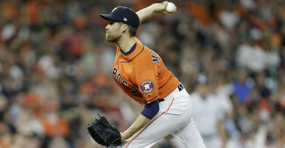 Collin McHugh saved a taxed Astros' bullpen with three innings of one-run, one-hit baseball after Dallas Keuchel could not complete six innings. Photo: Melissa Phillip/Houston Chronicle