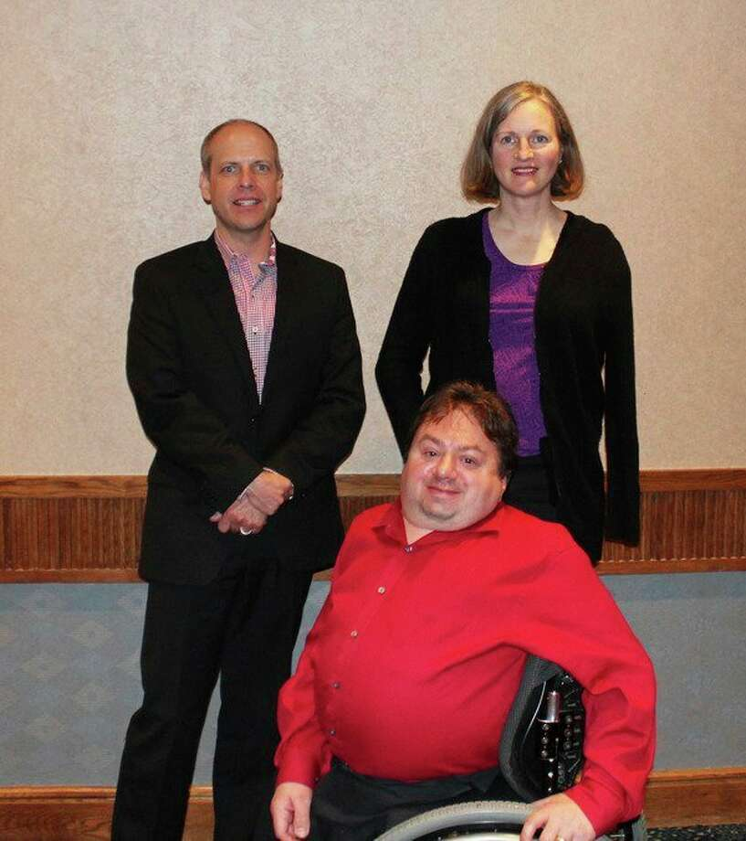 Disability Network of Mid-Michigan Board of Directors Officers: John Searles, vice president, left; Michelle Ursuy, secretary, right; Tom Provoast, president, front. Not pictured: Robbie Waclawski, treasurer.