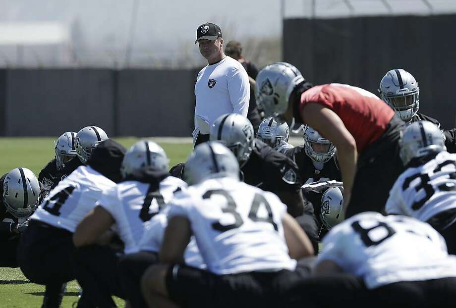 Coach Jon Gruden is working with 21 new Raiders that are experienced NFL players. Photo: Jeff Chiu / Associated Press
