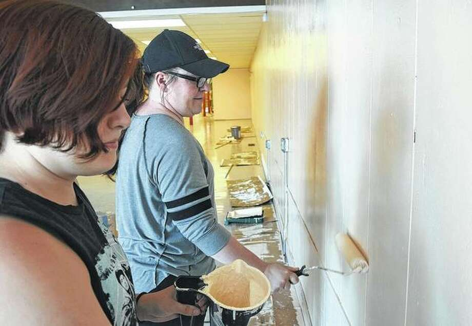 Ashley Briggs (right) and her daughter, Raelynn Hodel, paint the walls at 54 N. Central Park Plaza on Wednesday in preparation for the opening of a new bakery. Photo:     Samantha McDaniel-Ogletree | Journal-Courier