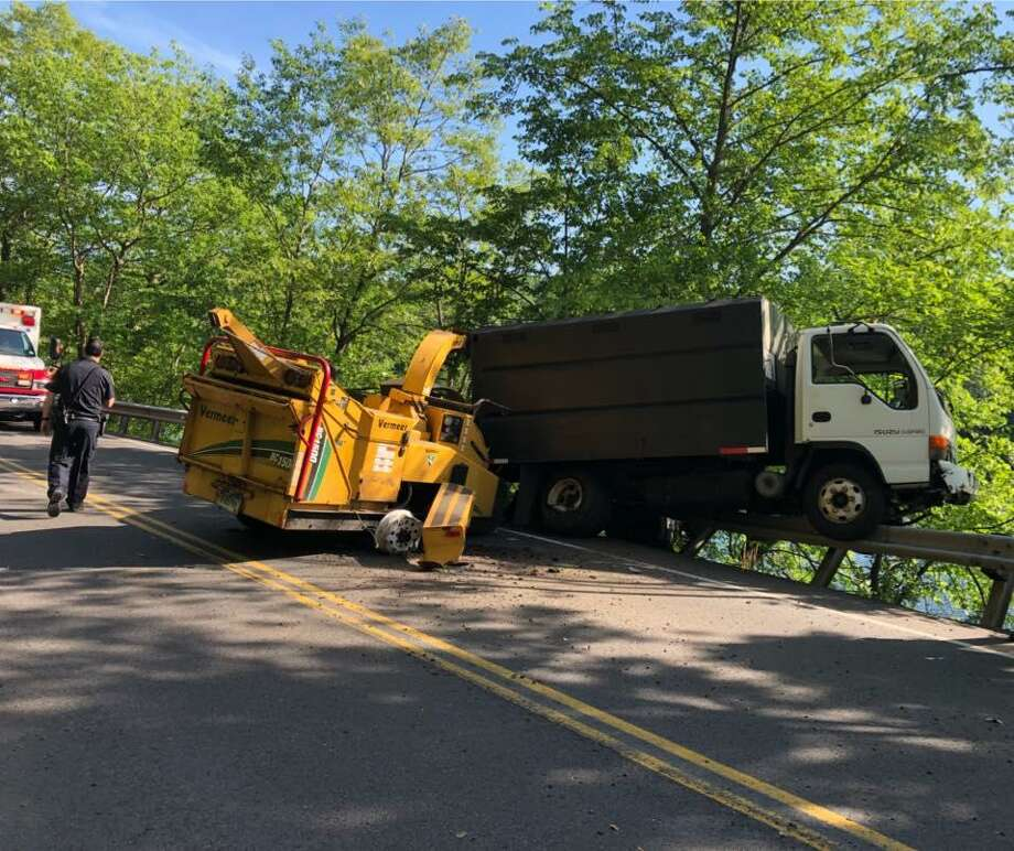 Route 34 in Derby was closed for about 90 minutes on Wednesday, May 30, 2018 after a truck towing a woodchipper went off the road. The truck became hung up on the guardrail just above the Housatonic River. Photo: Storm Engine Co. /Ambulance Corps Co. 2 Photo