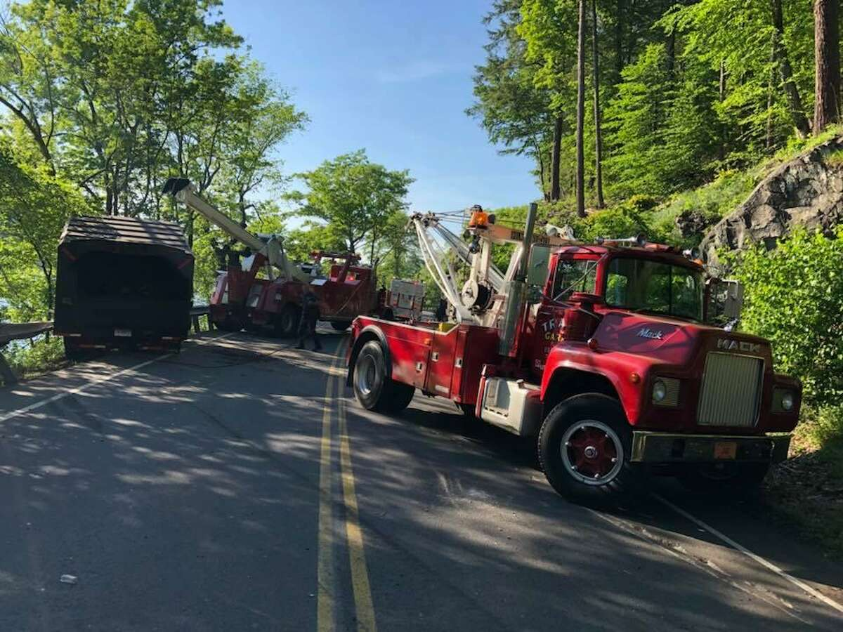 Route 34 in Derby was closed for about 90 minutes on Wednesday, May 30, 2018 after a truck towing a woodchipper went off the road. The truck became hung up on the guardrail just above the Housatonic River.