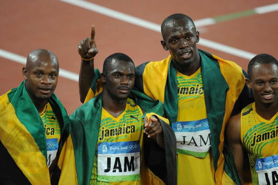 From Front L Jamaicas Asafa Powell Nesta Carter Usain Bolt And