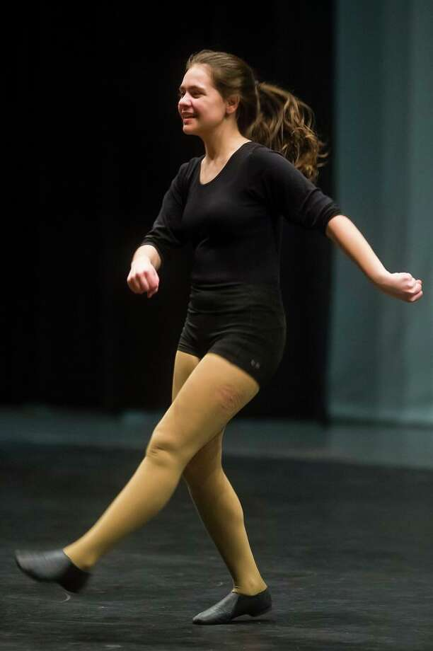 Emma Massey dances during a May 18 rehearsal for 'Circus Circus,' an original dance musical written and choreographed by Natalie Schwartz of Midland. (Katy Kildee/kkildee@mdn.net)