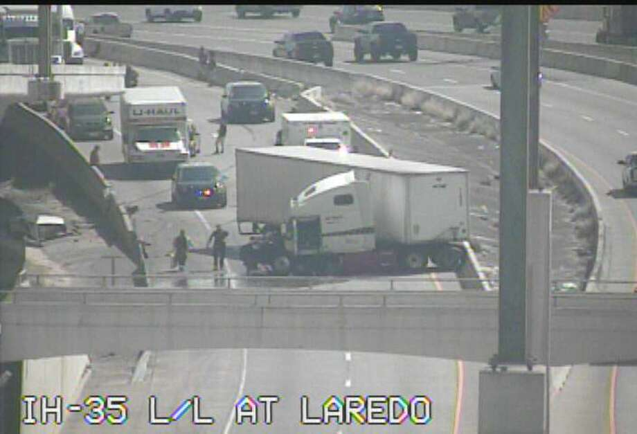 It is unclear what caused the crash, but Texas Department of Transportation traffic cameras show the big rig completely jack-knifed, blocking both lanes near South Laredo Street. Photo: Texas Department Of Transportation