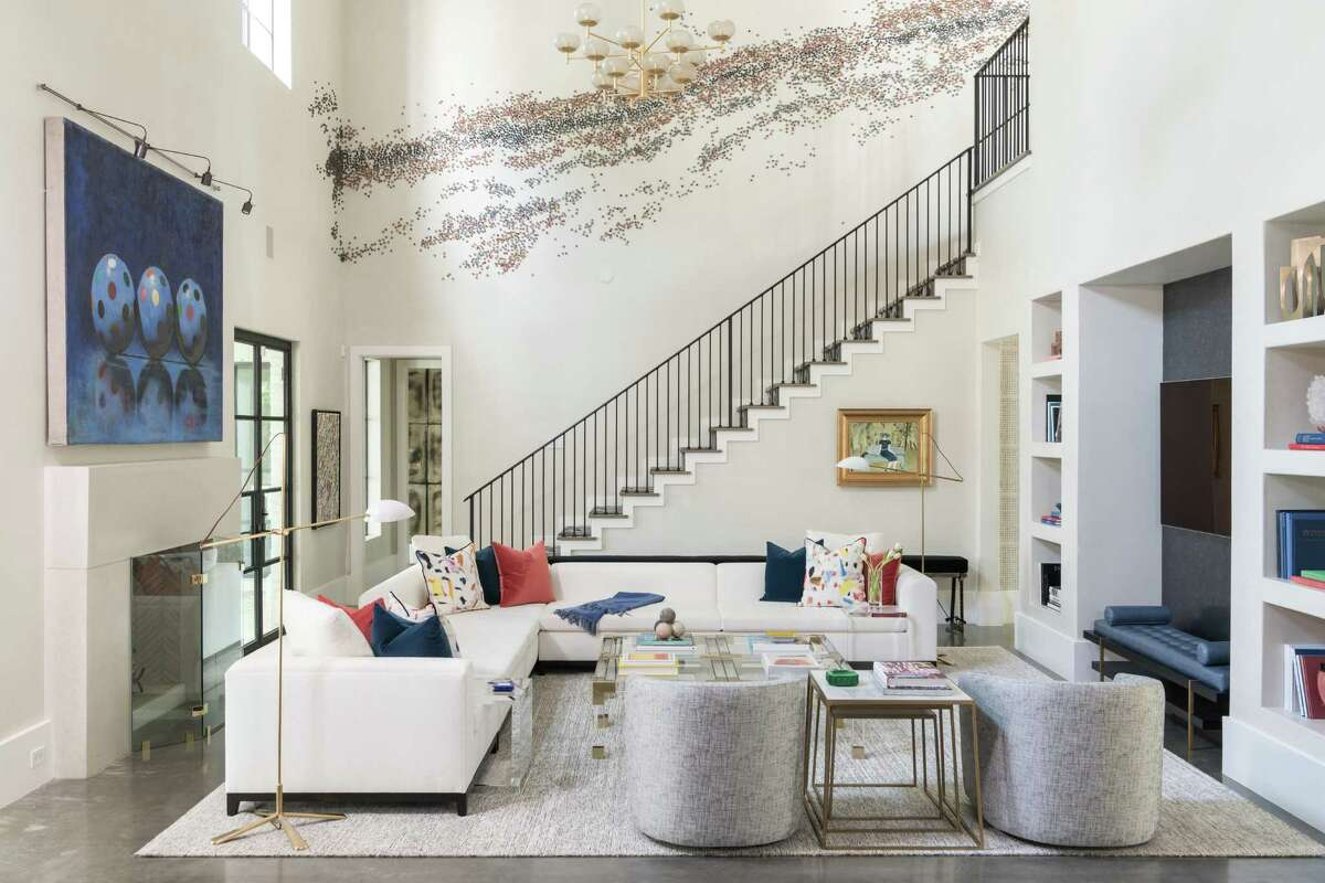 A Paul Fleming art installation runs up the staircase wall off of the family room of the Oak Estates home of Josh and Lisa Oren. Their home was designed by Laura Umansky of Laura U Interior Design.