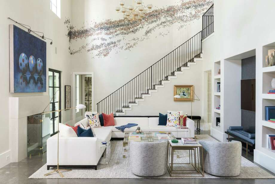 A Paul Fleming art installation runs up the staircase wall off of the family room of the Oak Estates home of Josh and Lisa Oren. Their home was designed by Laura Umansky of Laura U Interior Design. Photo: Michael Hunter