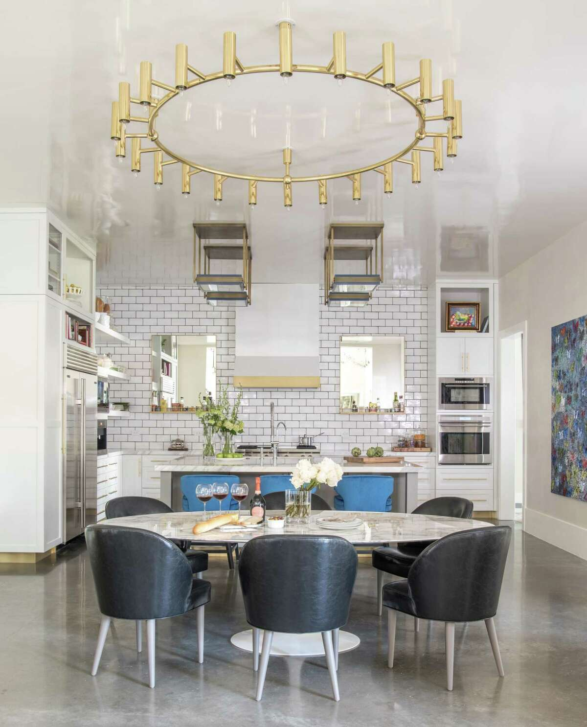 The Orens' home is filled with dramatic lighting, including these gold fixtures in the dining area and kitchen. Gold has been a big trend in lighting and in interior design in 2018.