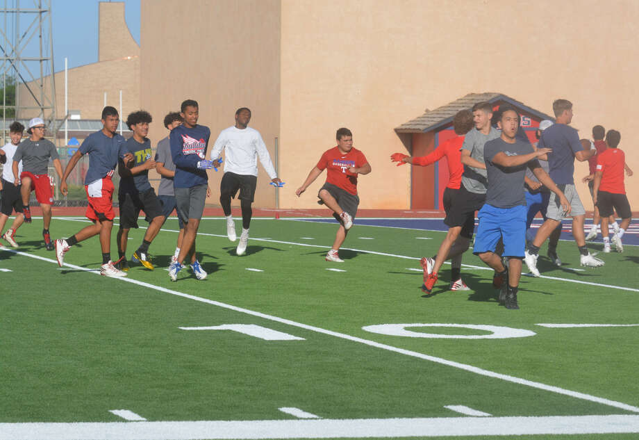 Plainview football players complete warmup drills to start the Fellowship of Christian Athletes 7 on 7 series on Tuesday at Greg Sherwood Bulldogs Stadium.