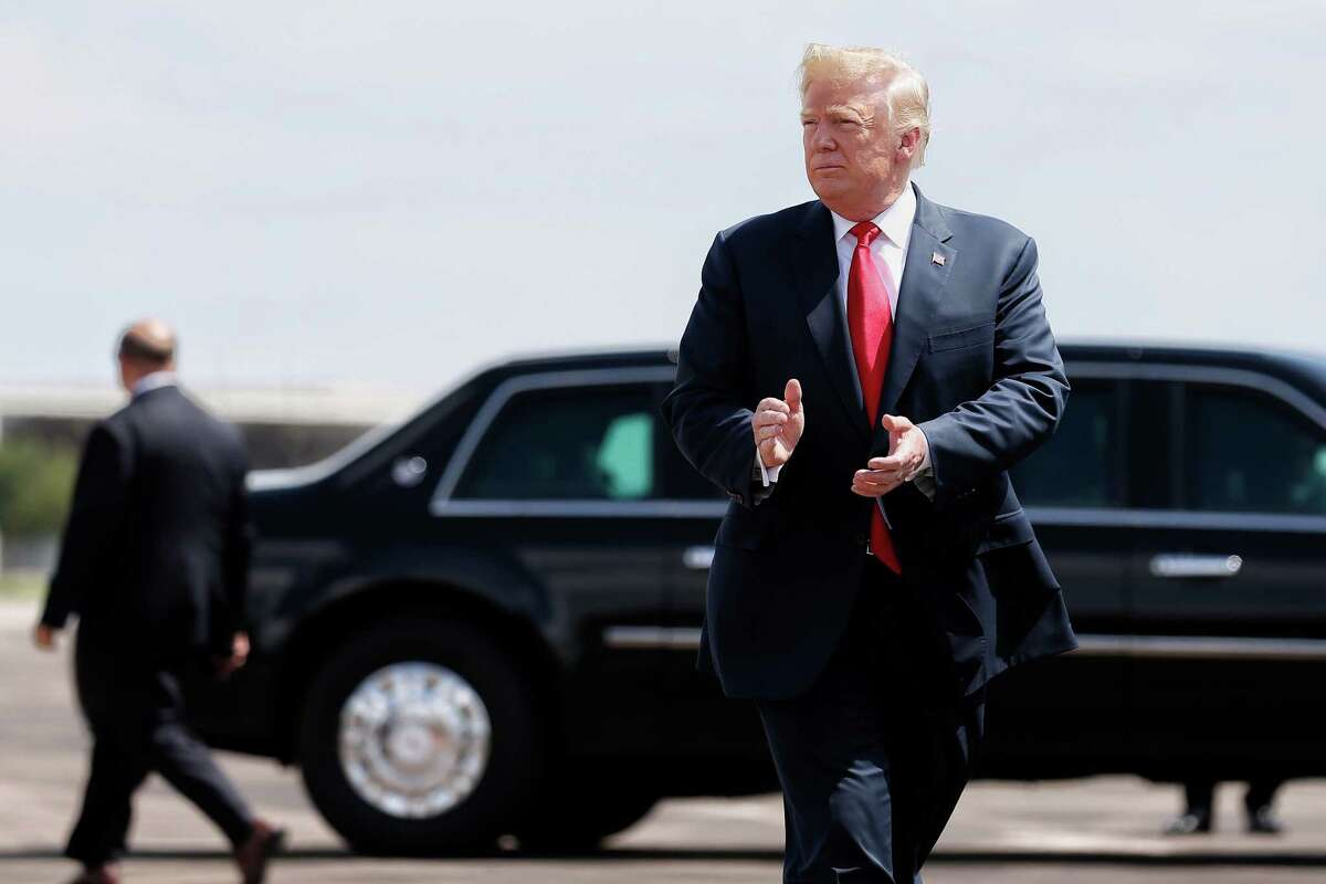 President Donald Trump cheers with supporters as he lands at Ellington Field Joint Reserve Base Thursday, May 31, 2018 in Houston. Trump will be meeting with Santa Fe family members and community leaders before heading to a fundraising event.