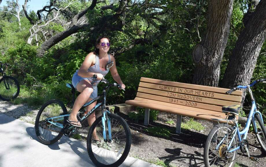 Taking a break from working construction as part of the effort to help the Rockport/Fulton area recover from the damage caused by Hurricane Harvey, Nicole Kramer, gets up close with nature on the Tule Creek Hiking and Biking Trail. Photo: Ralph Wininngham /For The Express-News