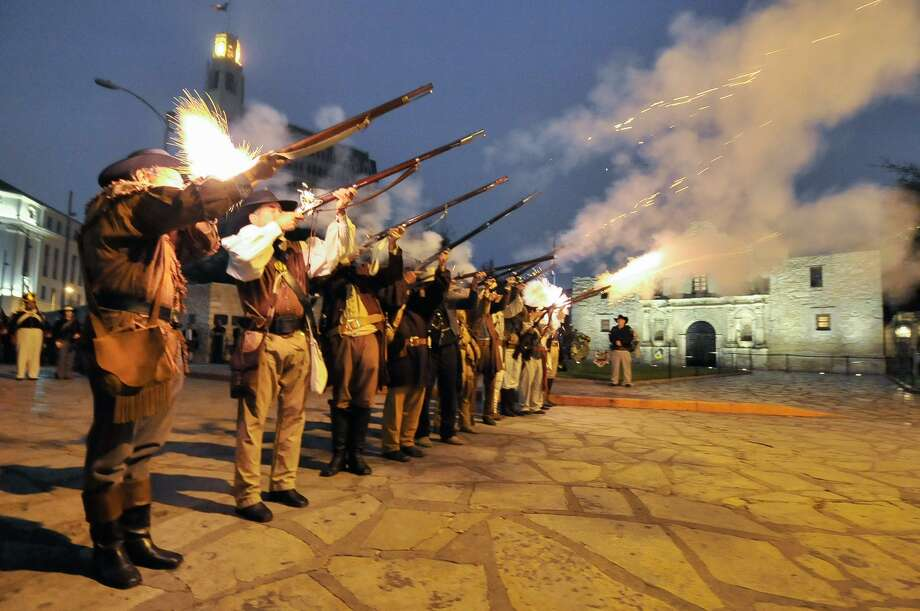 Re-enactors and descendants of the Alamo fire musket volley during the annual Dawn at the Alamo ceremony. Photo: Robin Jerstad /San Antonio Express-News