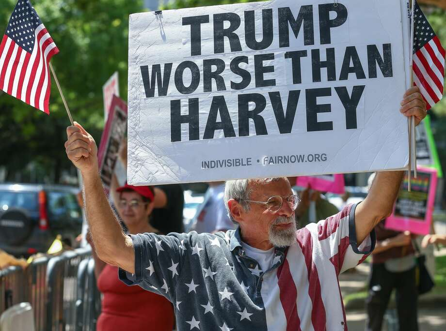 Ira Dember, 70, holds up a sign in opposition to President Donald Trump gather outside The St. Regis Houston hotel, where the president will be speaking at a National Republican Senatorial Committee lunch Thursday, May 31, 2018, in Houston. ( Godofredo A. Vasquez / Houston Chronicle ) Photo: Godofredo A. Vasquez/Houston Chronicle