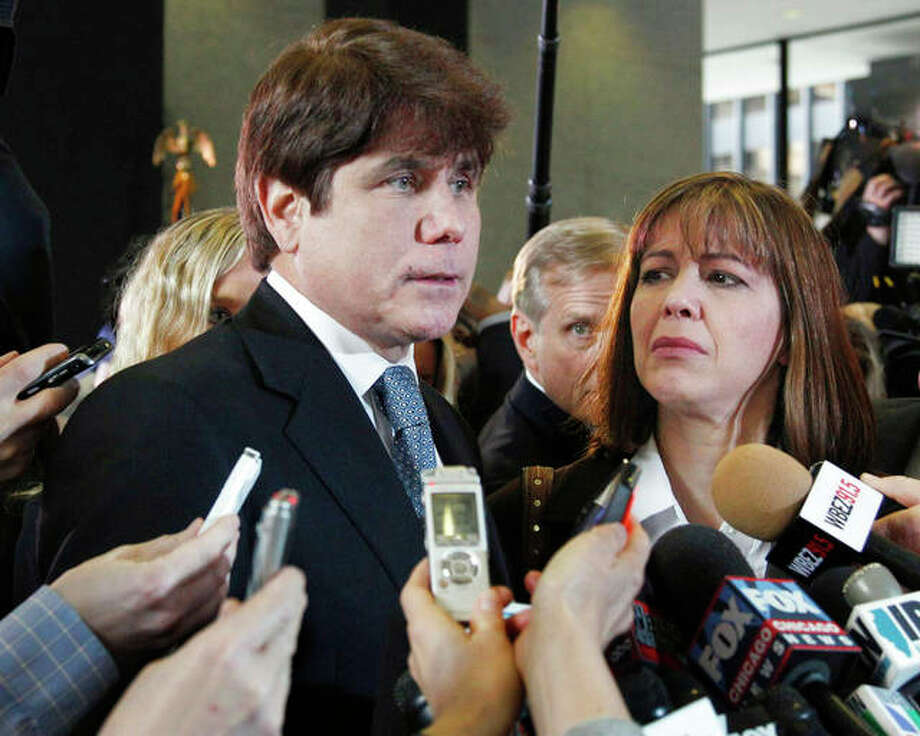 Former Gov. Rod Blagojevich speaks to reporters as his wife, Patti, listens at the federal building in Chicago. President Donald Trump says he is considering commuting the sentence of ex- Gov. Blagojevich and pardoning Martha Stewart. The comments came aboard Air Force One on Thursday after he tweeted that he planned to pardon conservative commentator Dinesh D'Souza. Blagojevich, a Democrat, began serving his 14-year prison sentence on corruption convictions in 2012. M. Spencer Green | AP