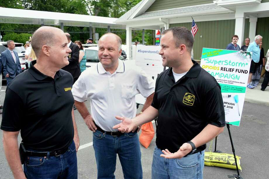 Jiff-E-Mart owners Bill, left, and James Chenot and Billy Chenot, right, operations manager, at the announcement of a new fundraising initiative known as the ÒSuperStorm Opioids Relief FundÓ Thursday May 31, 2018 in Troy, NY. One cent from every gallon of gas sold through November 2018 will be donated to support addiction awareness and substance abuse prevention, treatment, and recovery services in New York.  (John Carl D'Annibale/Times Union) Photo: John Carl D'Annibale, Albany Times Union / 40043950A