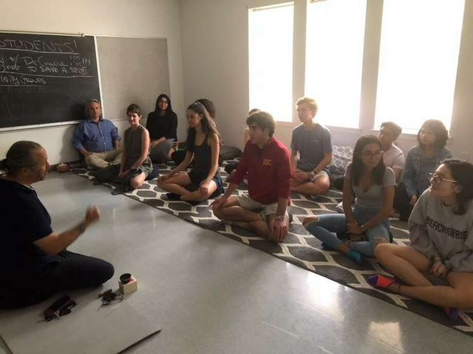 Behind the push of Nicolas Feder, an 11th grade student at The Awty International School in Spring Branch, the Awty Meditation Center is now a reality. Photo: Courtesy Photo