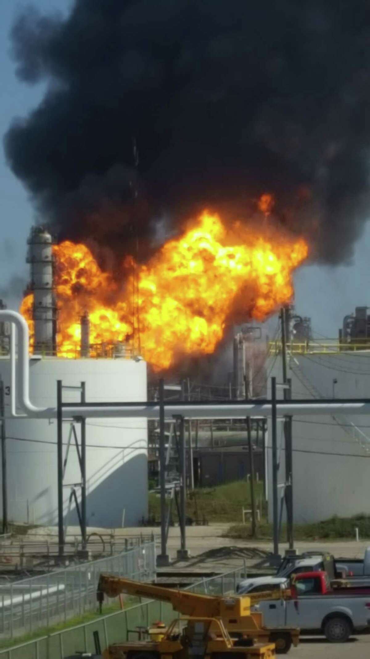 Flames and smoke can be seen April 19, 2018 after an explosion at Valero's Texas City refinery.
