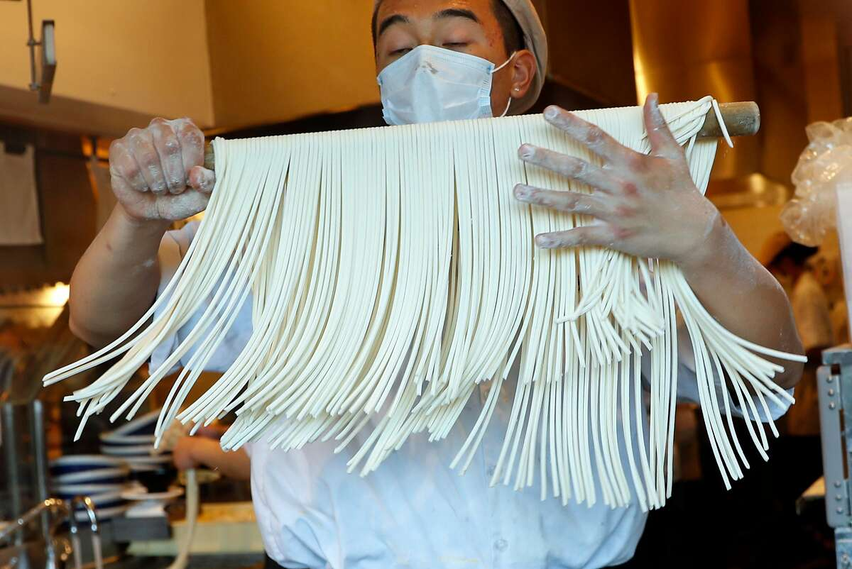 Kenny Nguyen makes udon noodles at Marugame Udon at Stonestown Mall in San Francisco, CA on Tuesday, May 29, 2018.