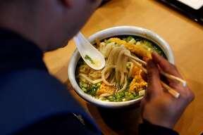 A diner eats Kakitama Udon at Marugame Udon at Stonestown Mall in San Francisco, CA on Tuesday, May 29, 2018.
