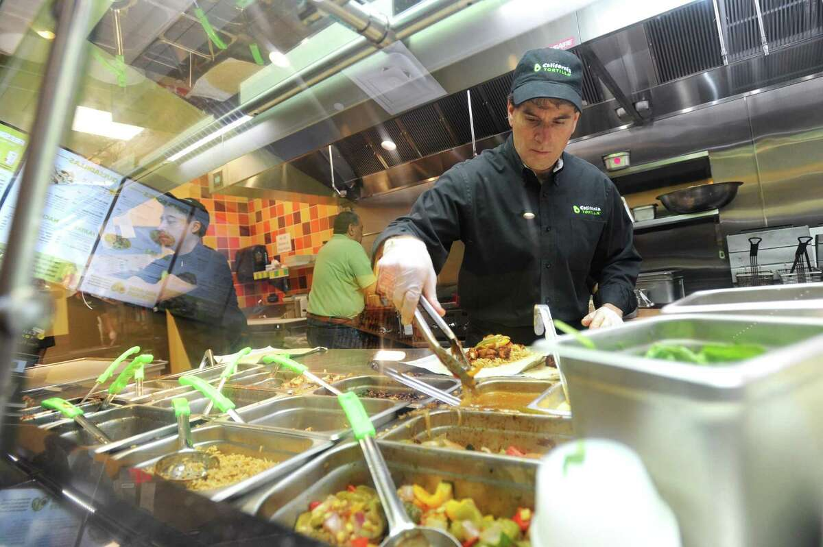California Tortilla co-founder Keith Goldman stands on the line and makes a burrito in California Tortilla's new restaurant at 300 Atlantic St., in downtown Stamford, Conn., on Wednesday, May 30, 2018.