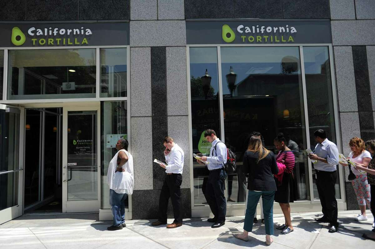 A line of people wait to enter the new California Tortilla restaurant at 300 Atlantic St., in downtown Stamford, Conn., on Wednesday, May 30, 2018.