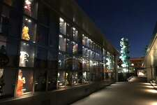 Evening lights illuminate the Chihuly Bridge of Glass in Tacoma's Museum District.