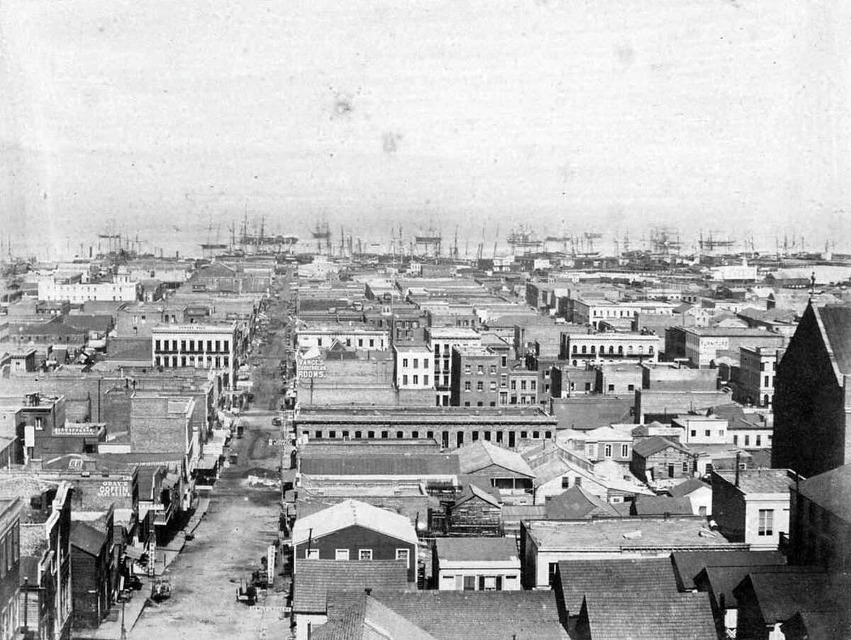 View down Sacramento street, May 1855: This view is the fifth plate in Fardon's seven-plate panorama. From the slopes of the Clay Steet Hill (Nob Hill), the view is to the east down Sacramento Street to the bay. At the right is the back of Saint Mary's Church (which faces California Street at Dupont.) On Sacramento, several signs in Chinese are visible, as is a