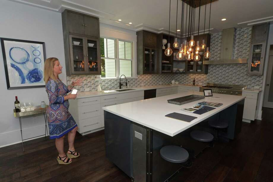 Susan Vanech tours her five-bedroom house Wednesday, May 30, 2018, at 5 Ridgewood Lane that is for sale for $1, 648,000 in Westport, Conn. Vanech is marketing the house for cryptocurrency buyers as well. Photo: Erik Trautmann / Hearst Connecticut Media / Norwalk Hour