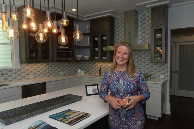 Susan Vanech tours her five-bedroom house Wednesday, May 30, 2018, at 5 Ridgewood Lane that is for sale for $1, 648,000 in Westport, Conn. Vanech is marketing the house for cryptocurrency buyers as well.