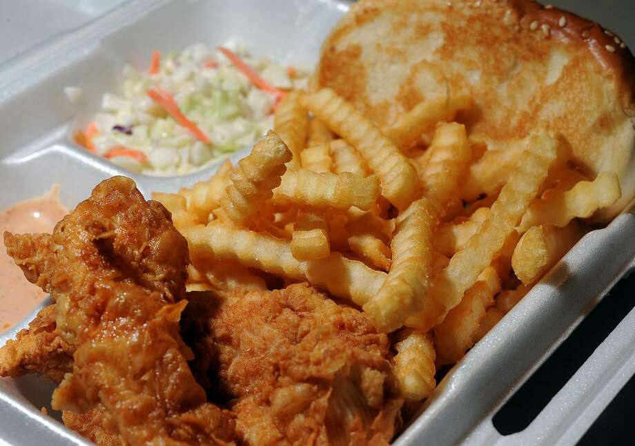 Along with a chicken sandwich, Raising Cane's serves up tenders, fries and a secret sauce. Photo: Guiseppe Barranco, Guiseppe Barranco/The Enterprise