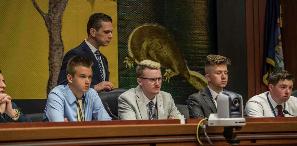 "Students from various counties within the Assembly District of Angelo Santabarbara, background. take the positions of Assemblymen and women as they run a ""hearing"" on the effect of untethering standardized tests from teacher evaluations at the Legislative Office Building Thursday May 31, 2018 in Albany, N.Y.  (Skip Dickstein/Times Union) Photo: SKIP DICKSTEIN, Albany Times Union / 20043954A"