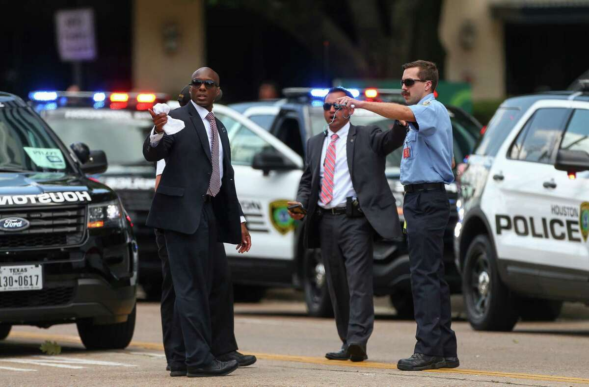 Authorities President Donald Trump's motorcade leaves The St. Regis Houston hotel after speaking at a National Republican Senatorial Committee lunch Thursday, May 31, 2018, in Houston.